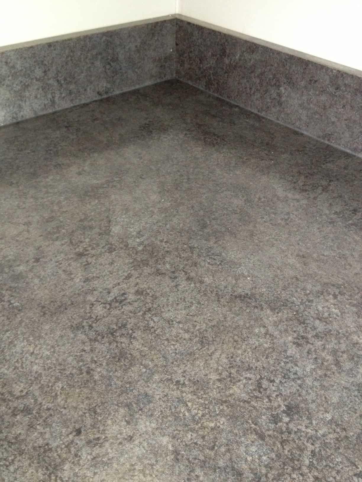 A close up of grey, veneer countertops