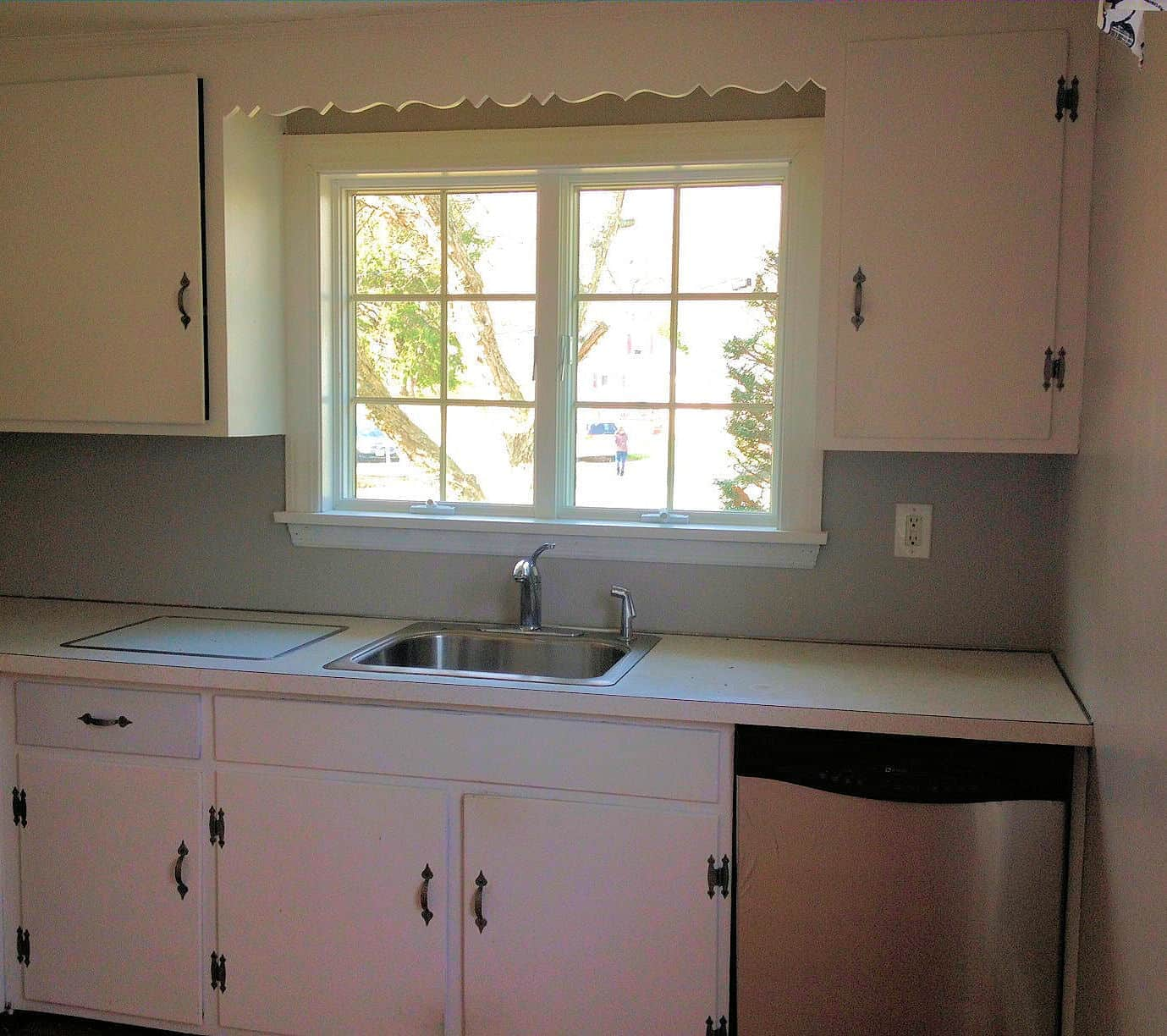 Walls painted gray and white cabinets