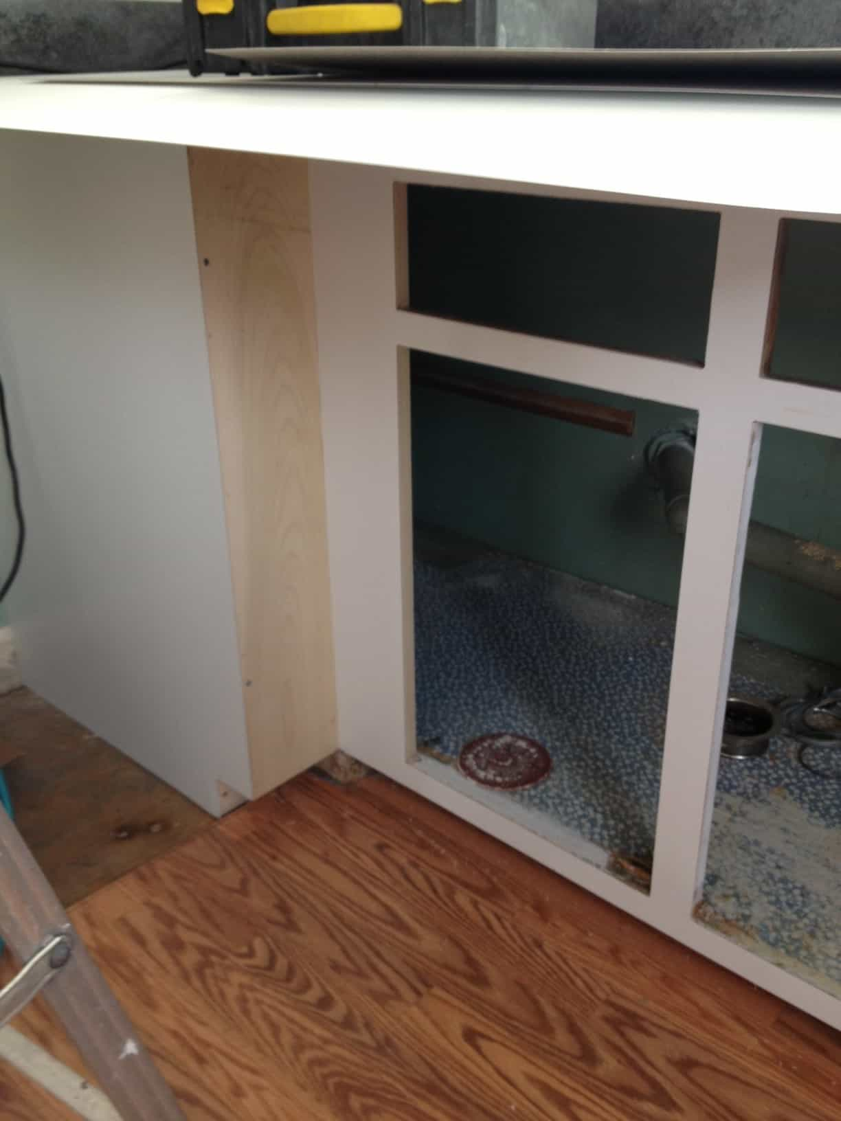 Open cabinets with doors removed