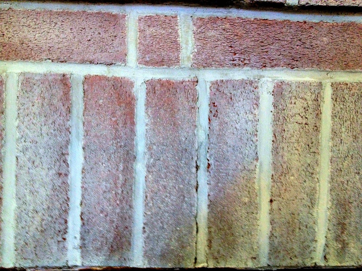 use white paint and water to stipple the brick with whitewash