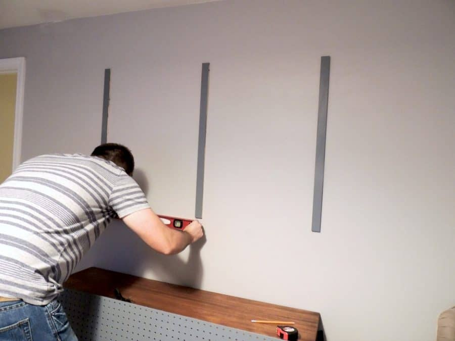 A person using a level on a wall