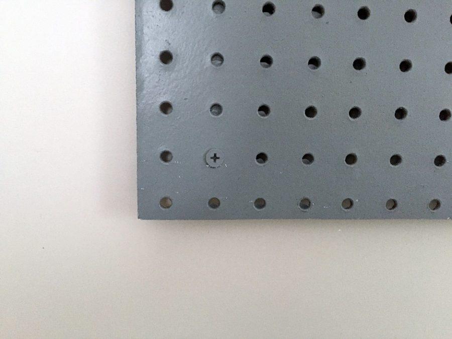 screw pegboard to wall