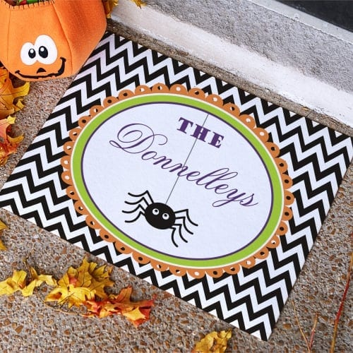 I love this personalized Halloween themed doormat that's perfect to welcome trick-or-treaters to your home!
