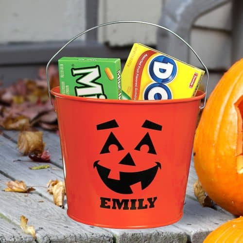 A personalized jack-o-lantern candy bucket is perfect for your trick-or-treating kids