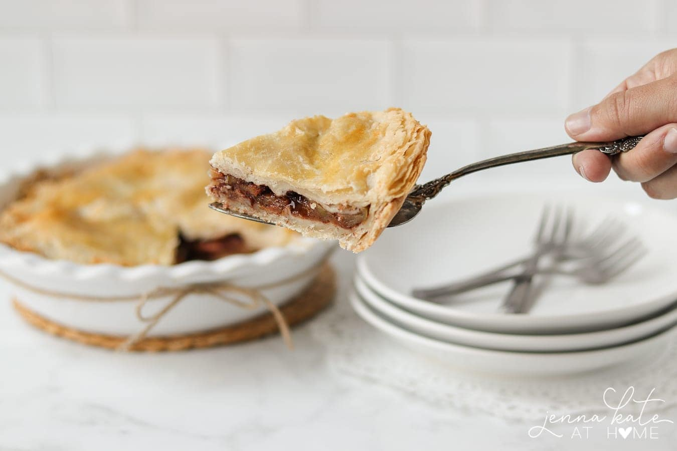 slice of apple pie on  fork