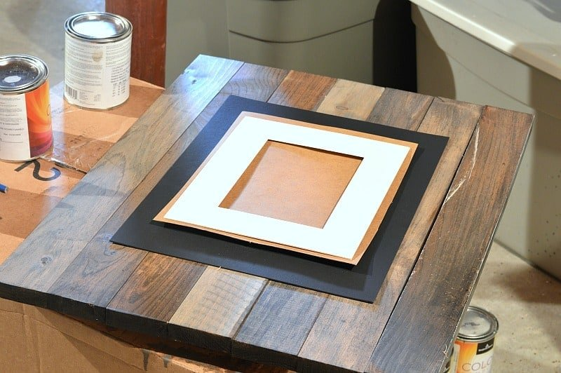 Attaching the mat to the front of the picture frame