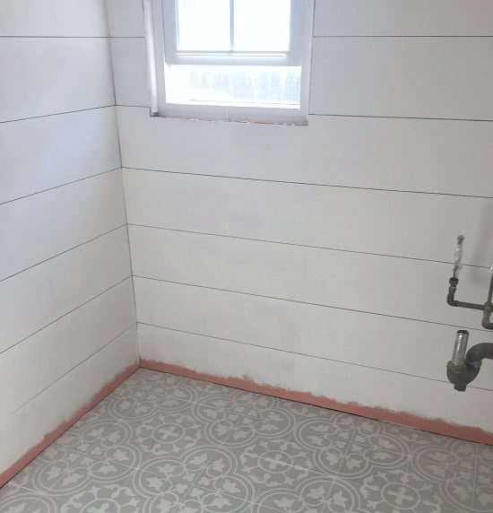White shiplap and gray cement tile floor