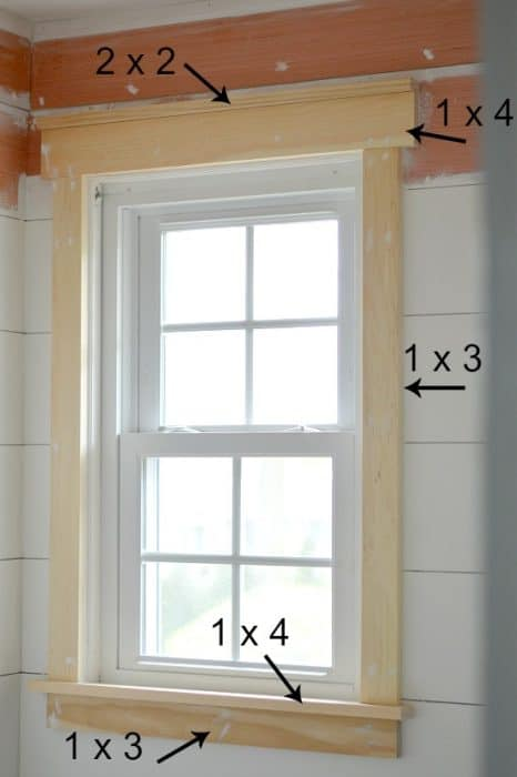 Updating window trim to a craftsman or farmhouse style will add character to a builder grade home