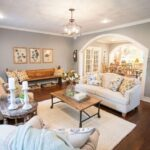 A neutral couch, magnolia stems and fun accent pillows complete this fixer upper living room. Want copycat sources for all these products? Click to get them!