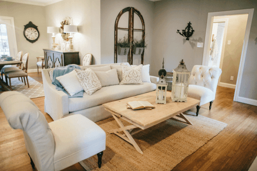 Delightful Joanna Gaines Designed Living Room With Neutral Couch And Light Wood  Furniture