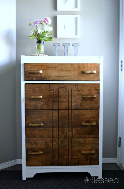 The contrast between the dark stained wooden drawers and clean white frame makes this updated dresser a statement piece