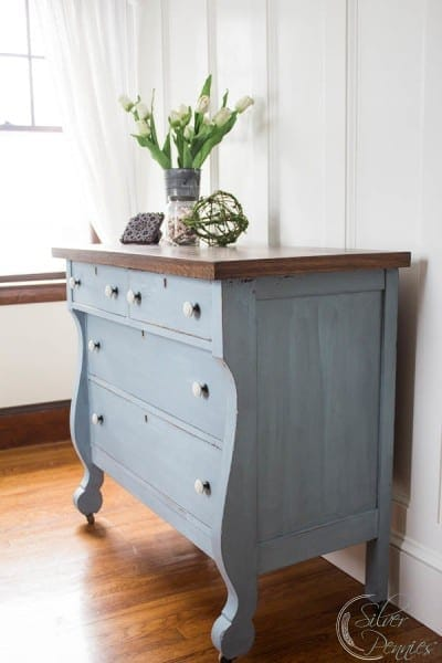 This Empire dresser has a fresh coat of steel blue milk paint, which gives the dresser a weathered, white-washed finish