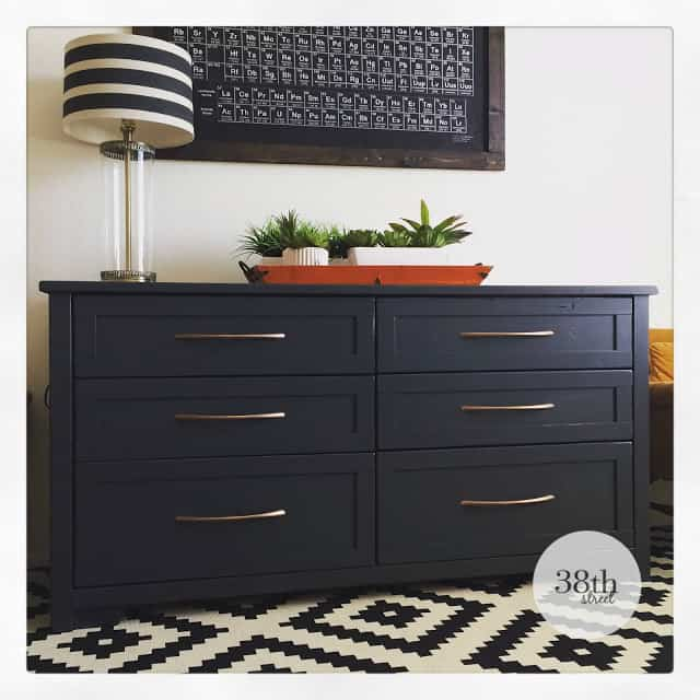 This dresser makes a statement with a stark-black paint and simple gold hardware.