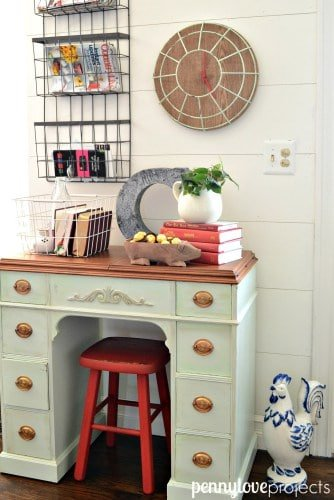 This child's desk was updated with a light mint green paint, and accented with a rich copper paint on the drawer handles and desk top.