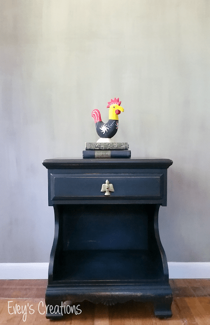 This farmhouse inspired nightstand was updated with black paint and distressed, giving it a genuine vintage feel
