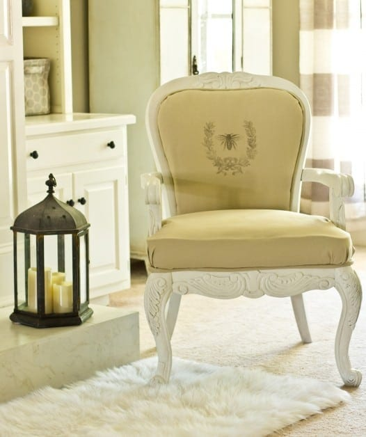 This French style chair is updated with cream upholstery and cream paint, bringing out the intricate woodworking detail