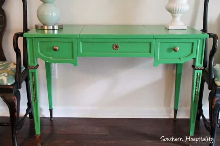 I love the gold accents on this green table--it really brings out the intricate detail on the table legs!