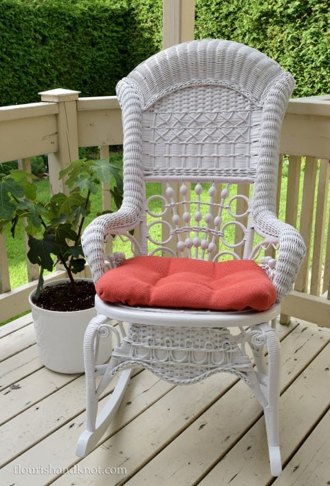 I love how bright this wicker rocking chair looks with a fresh coat of cream white paint. The orange seat cushion adds a bright pop of color
