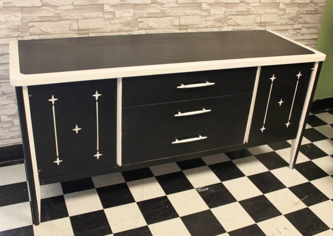 This upcycled console has a retro feel with it's all-black finish with white accents