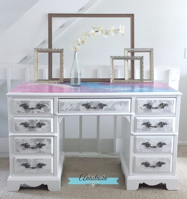 This updated desk is so colorful with a watercolor finish on the desk top, and intricate lace patterns on the drawers