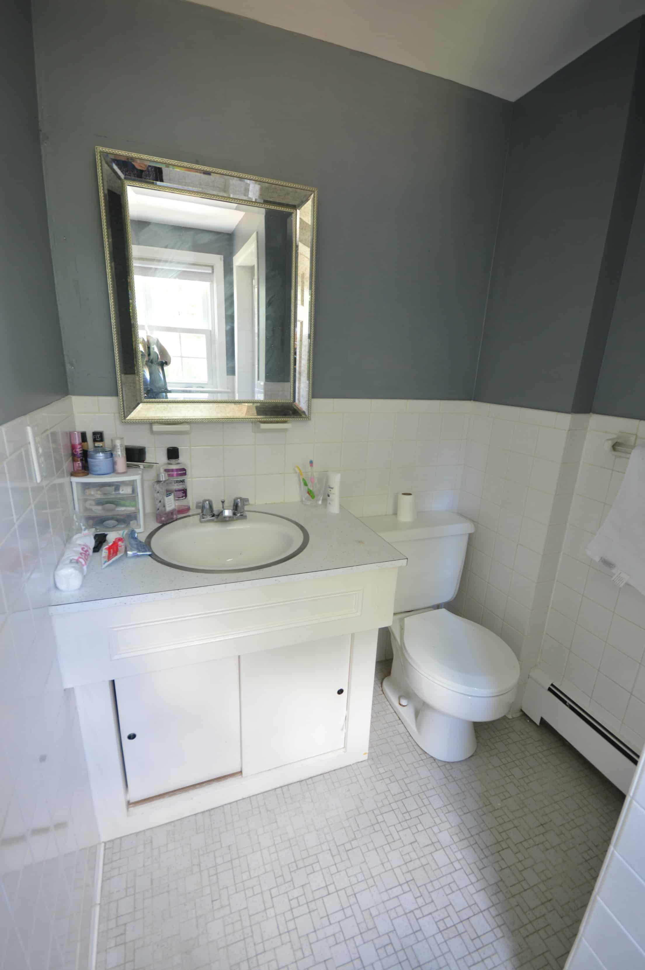 Our old master bathroom had a rusted toilet, ugly vanity, and dirty yellow grout