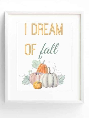 """A white frame with art featuring a group of pumpkins and the words """"I dream of fall"""""""