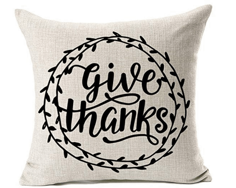 Cheap throw pillow from Amazon that says Give Thanks