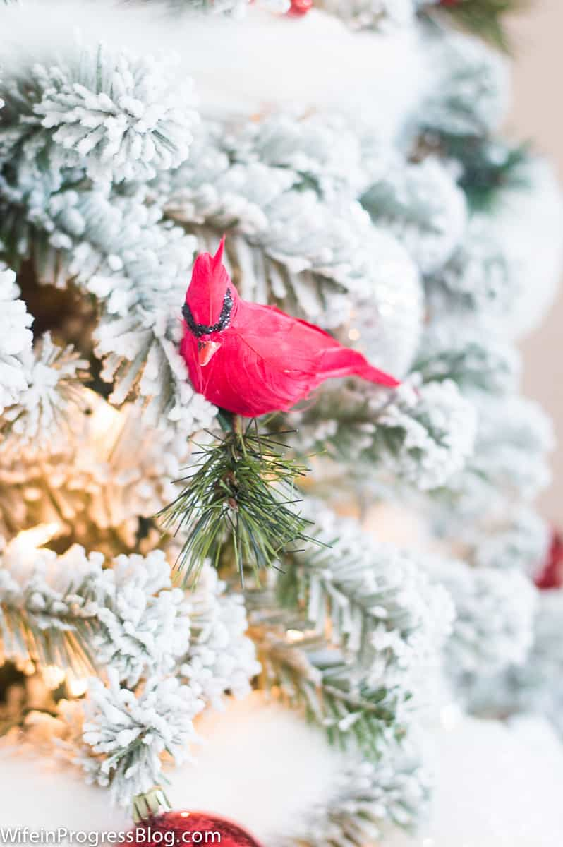 A red cardinal perched on the Christmas tree is a unique decoration idea