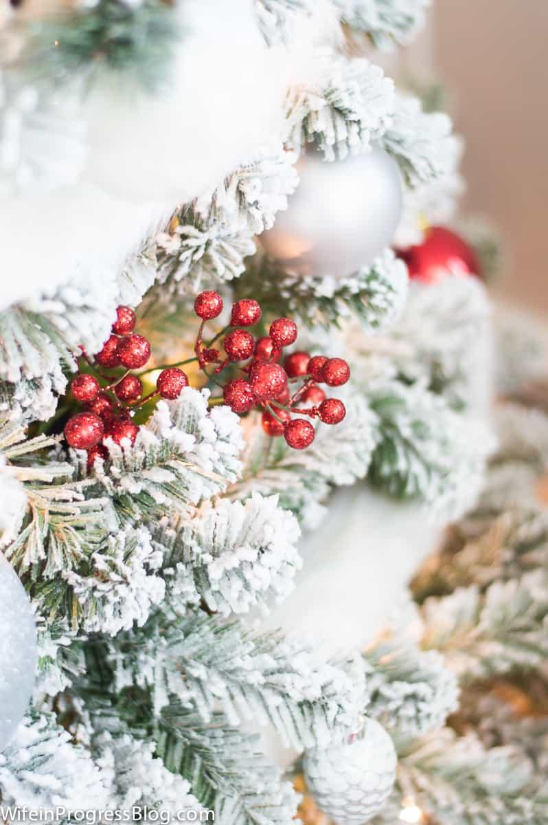 Berry picks on a flocked Christmas tree