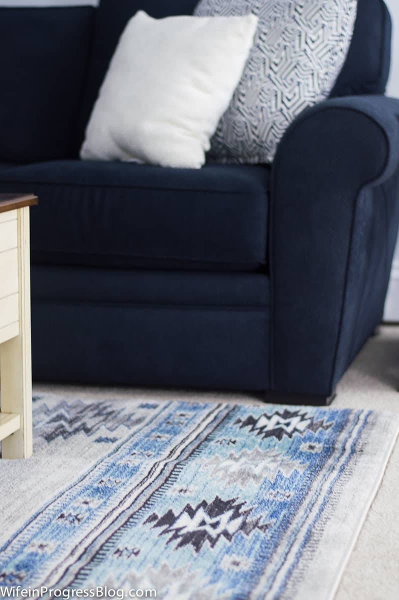 Blue printed area rug in basement
