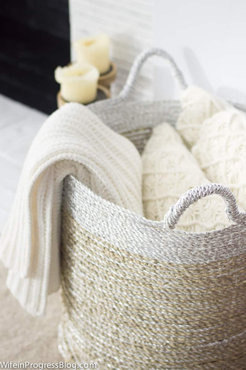 How to stay organized? Use baskets to corral pillows and blankets and keep your bedroom organized and tidy