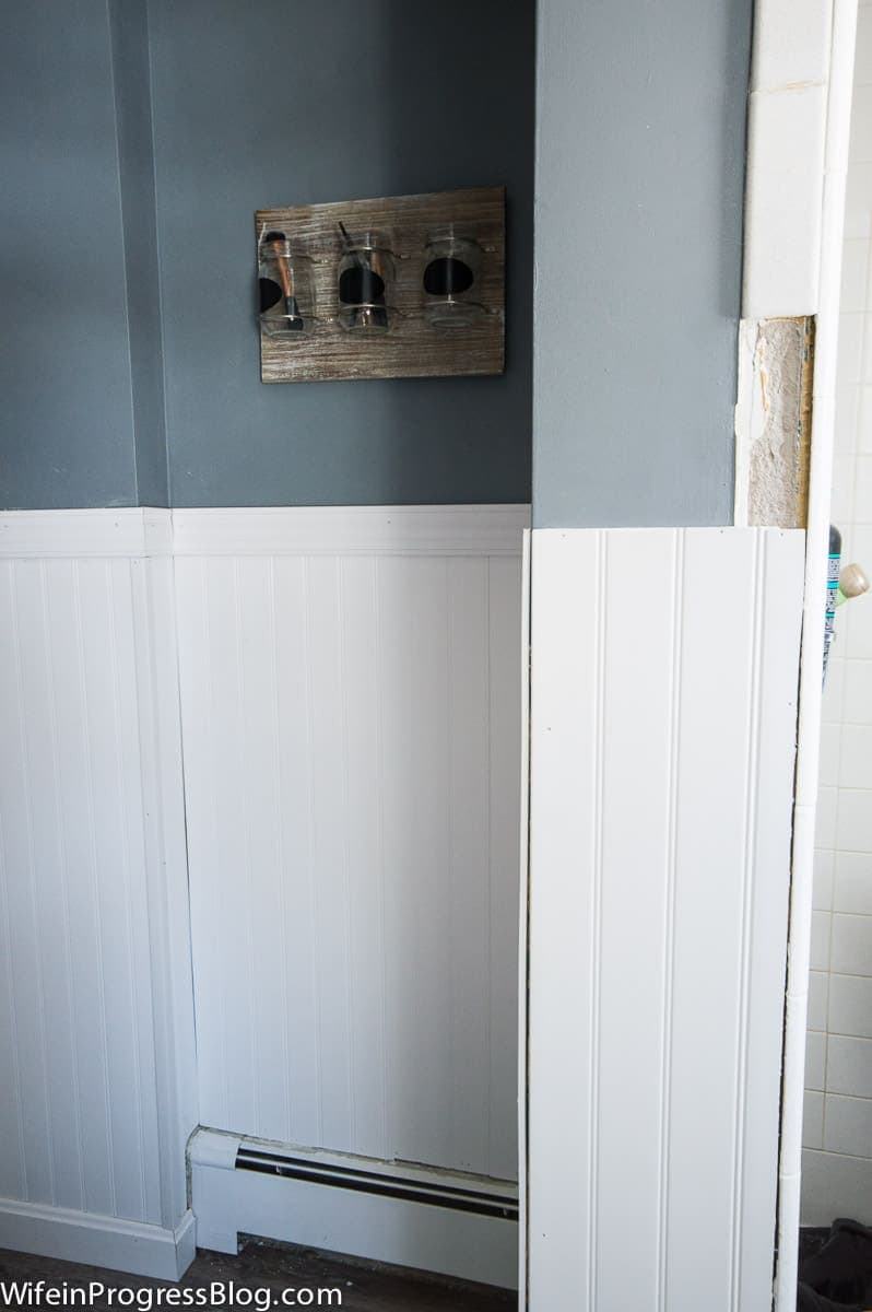 Work in progress - white beadboard being installed over walls damaged by tile removal