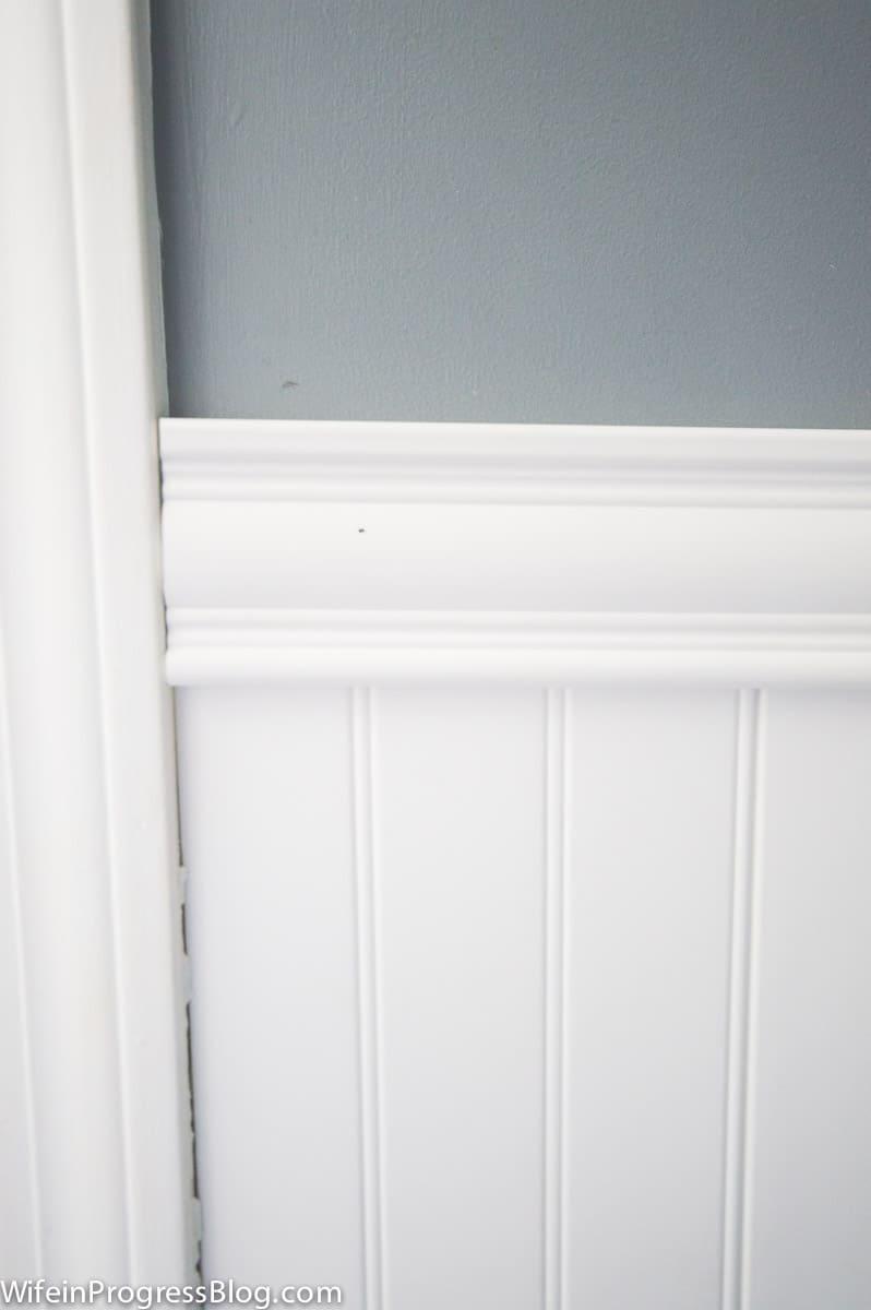 A closer look at vinyl beadboard and matching chair rail below a gray wall