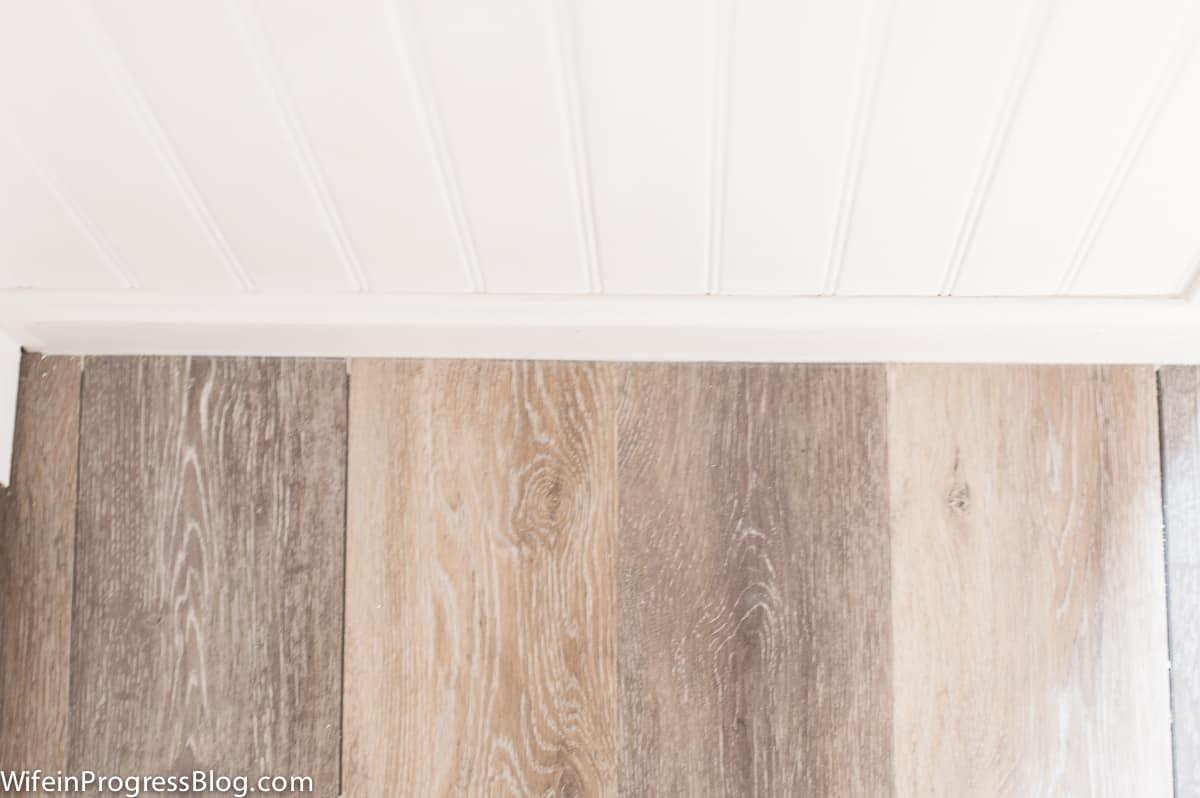 I love the rustic coastal look of our new waterproof vinyl flooring!