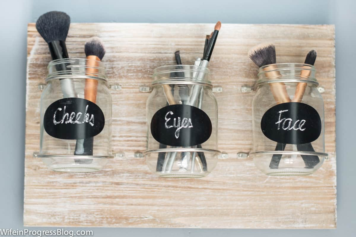 I created this mason jar makeup brush holder to help organize my makeup station in our master bathroom
