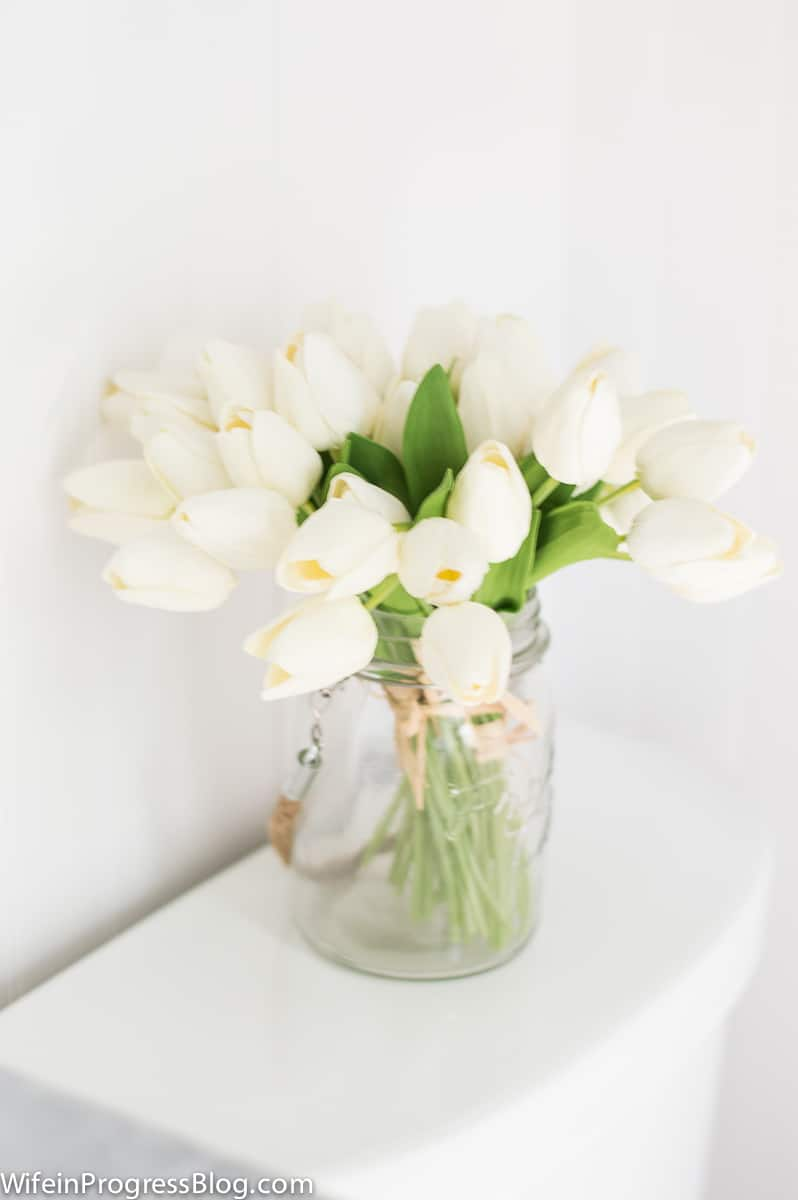 Fresh white tulips are a perfect accent piece for our farmhouse coastal style updated master bathroom