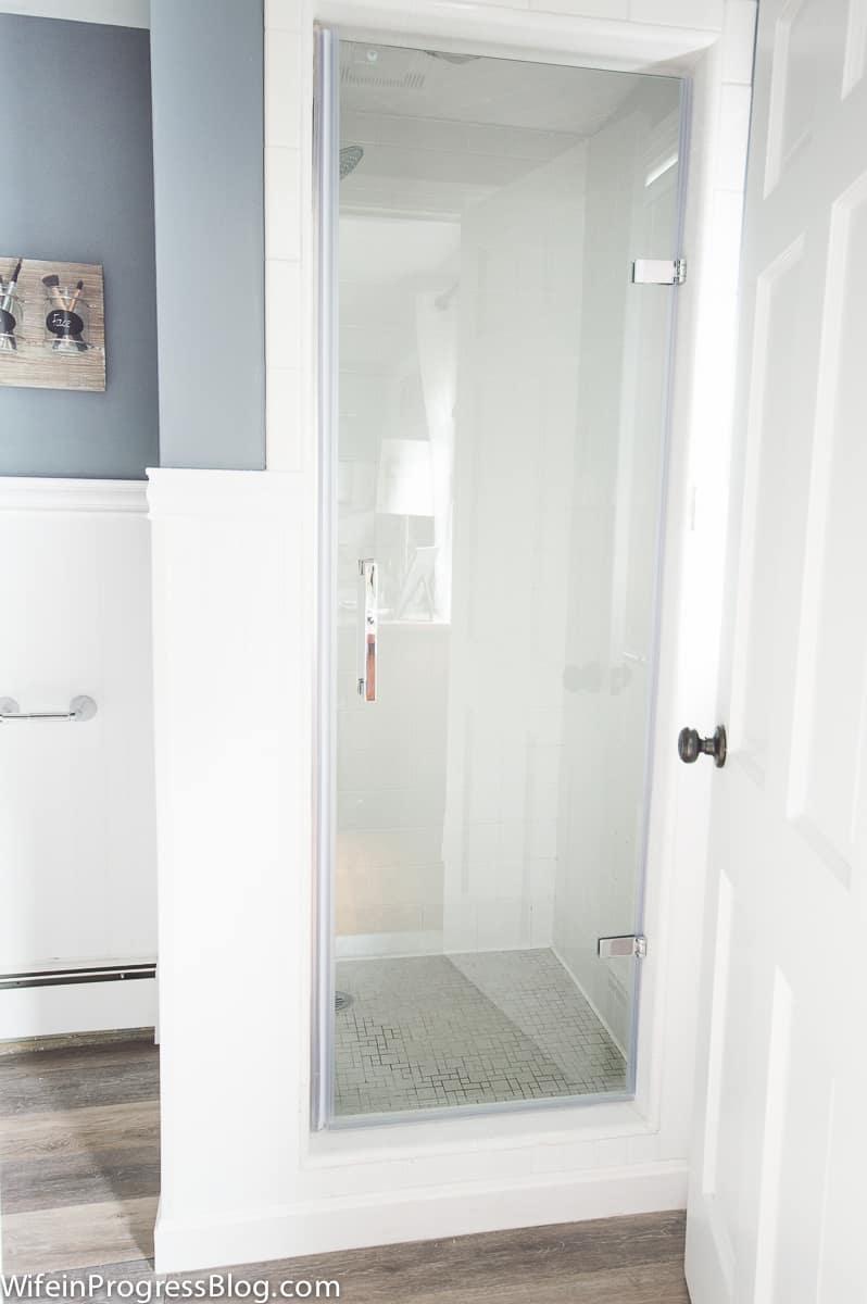 We installed a new frameless glass shower door on our master bathroom shower
