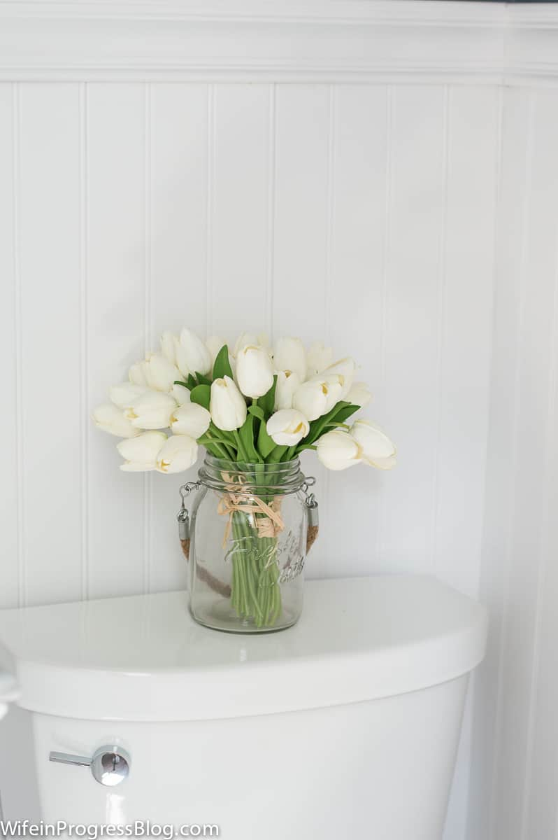 Fresh white tulips are the perfect coastal decor for our new master bathroom