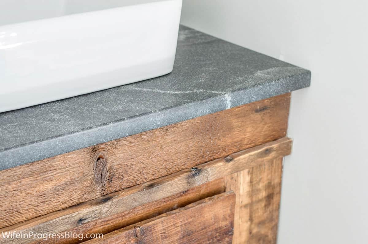 "Granite, ""Jet Mist"" in a modern farmhouse bathroom remodel"