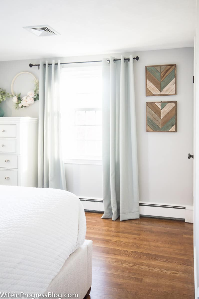 Gray walls with light streaming in through the bedroom window