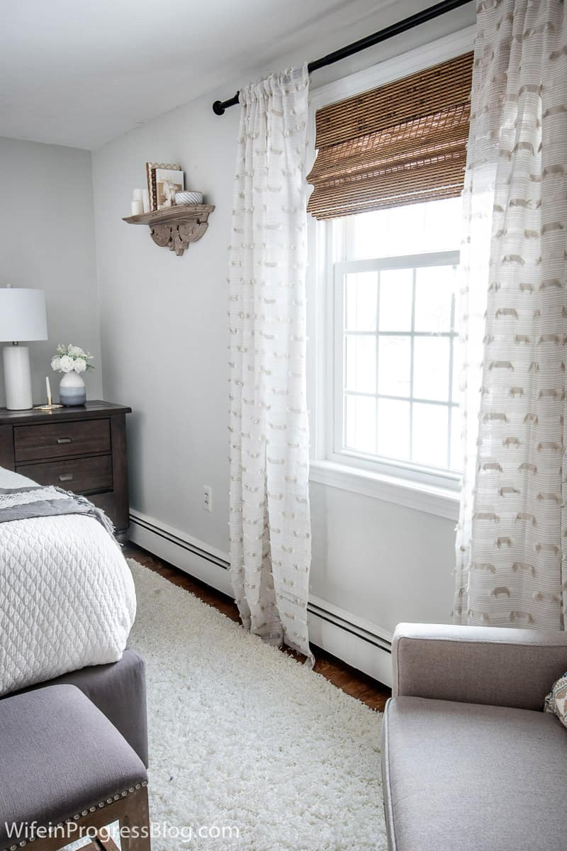 Sheer curtains keep this small master bedroom decor bright and fresh