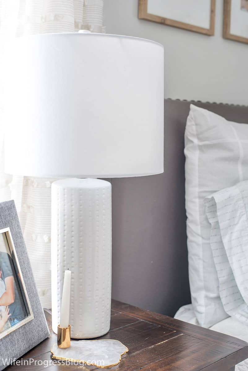 A simple white lamp adorns each nightstand in this small master bedroom makeover