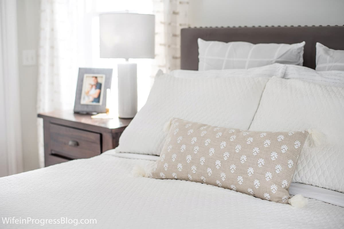 Add texture to the bed to bring interest to a small master bedroom