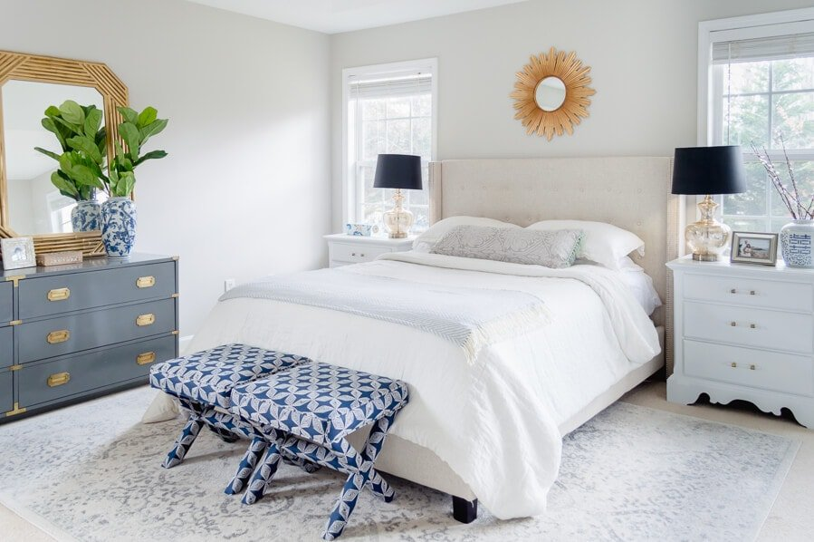Bedroom painted SW Agreeable Gray with white bedding and blue accents