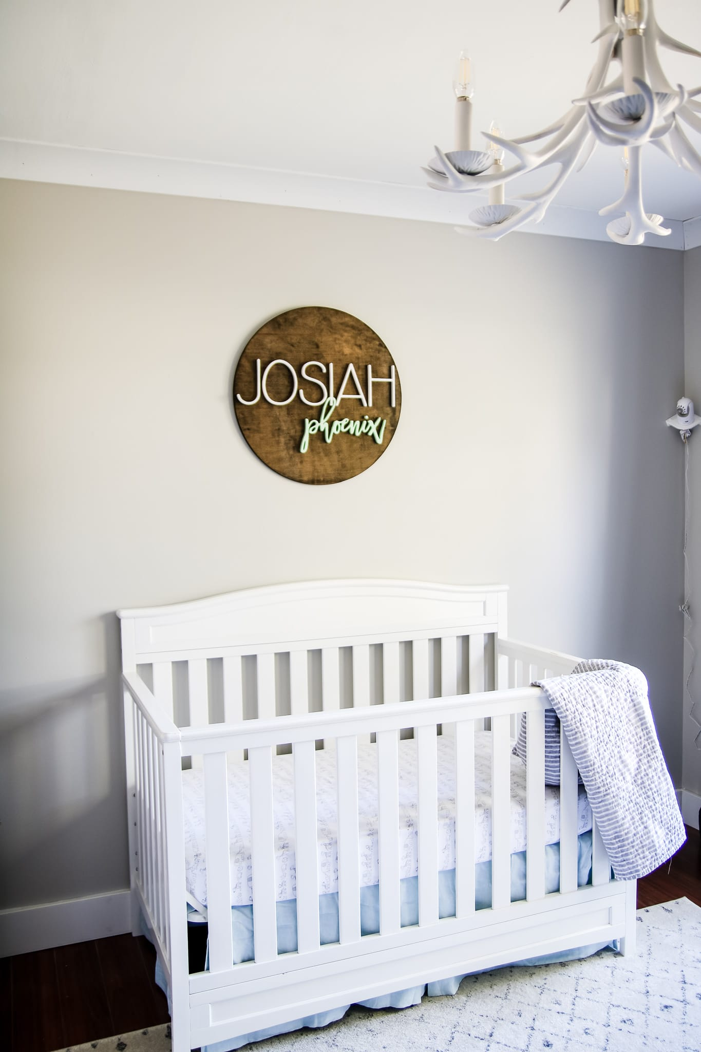 Nursery painted agreeable gray that shows both the warm and cooler side of the color