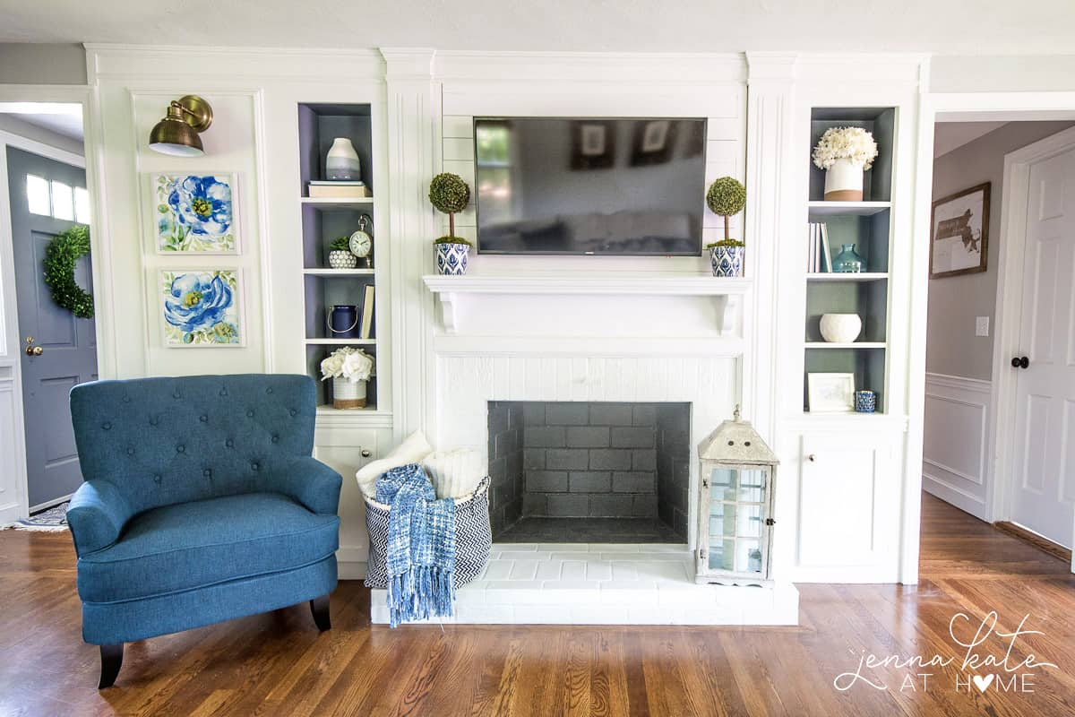 Navy blue accents, gray walls and plenty of crisp white for this coastal inspired living room