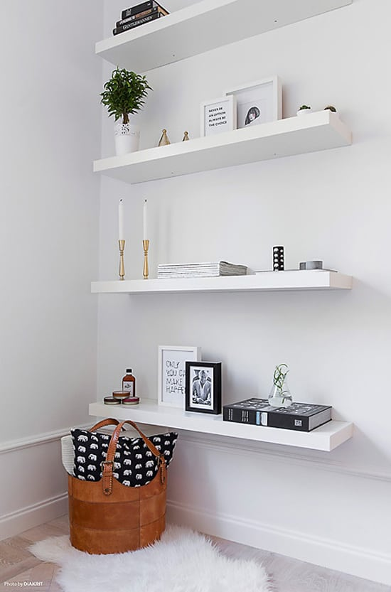 Adding shelves is a budget friendly way to add more storage space to a small bedroom