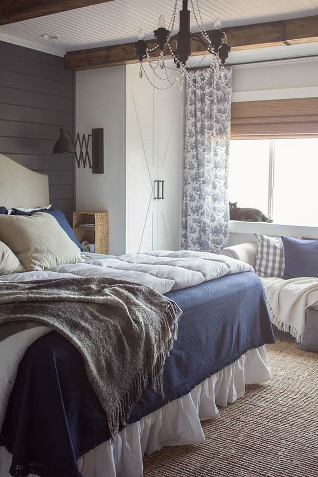 If you don't have floorspace, attach baskets to the wall to organize your bedside. Great budget tip for small bedrooms!