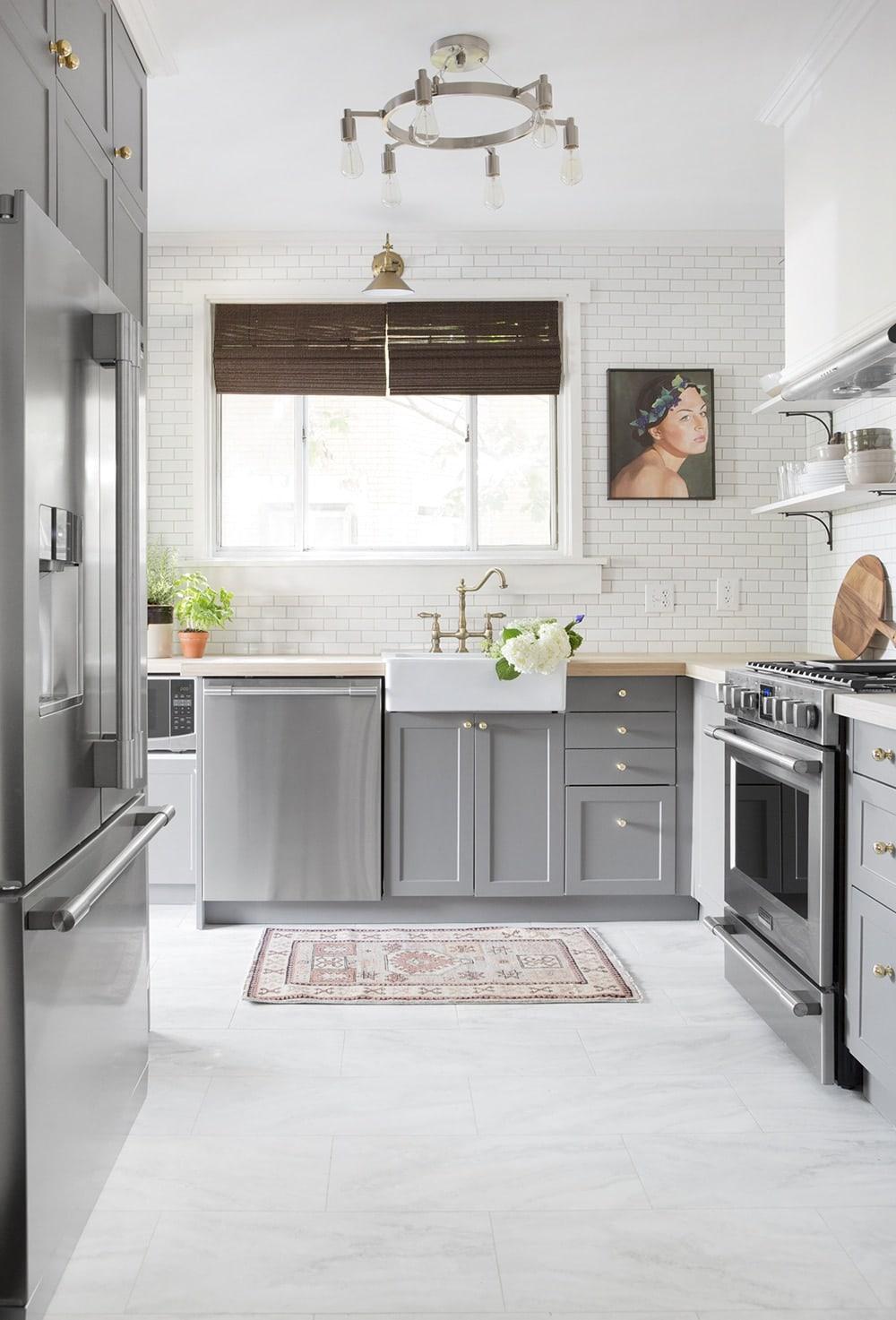 Kitchen with marble look luxury vinyl tile flooring