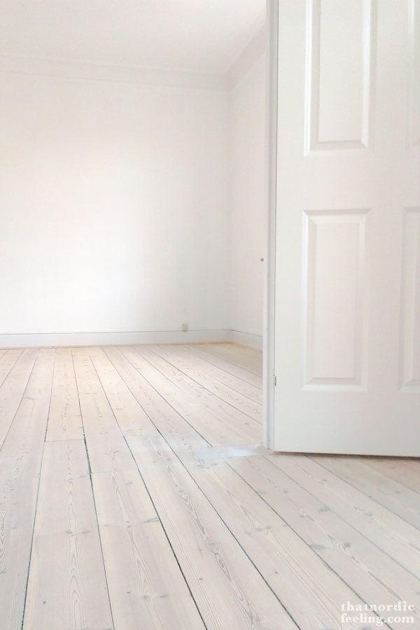 Whitewashed hardwood floors are a cheap flooring solution